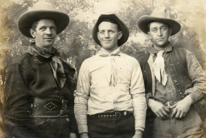 John Keenan, left, and his brother, Charles, right,  pose with their buddy,  Joe Riley, one of the several rodeo riders hired to play cowboys at the Betzwood studio.